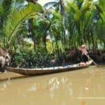 frau-rudert-boot-mekong-delta-vietnam
